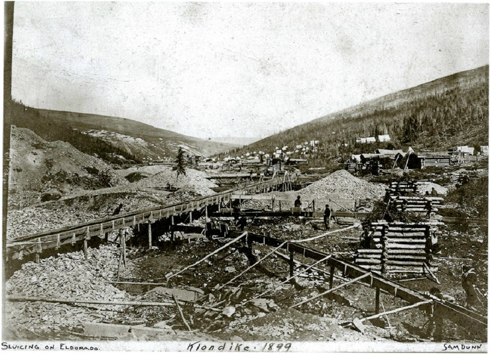 Diverted above ground steams (sluice boxes), mine tailings, and boardwalks on Eldorado in 1899.