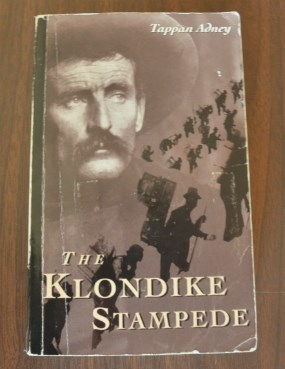 "Book cover with text ""Tappan Adney"" and ""The Klondike Stampede"""