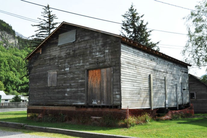 Modern photo of an old wooden building raised above the ground.