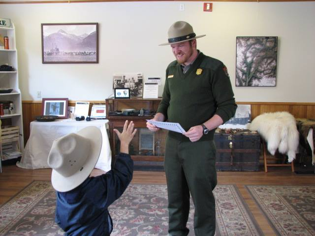 A ranger works with a child in the Junior Ranger Activity Center