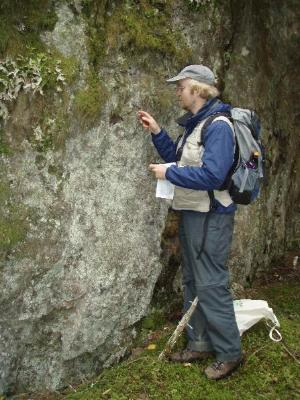 Collecting lichens on a rock outcrop at KLGO