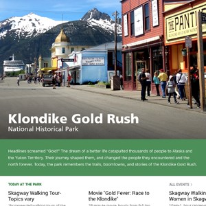 "Screen shot of a scenic town picture and text ""Klondike Gold Rush National Historical Park"" with menu items below."