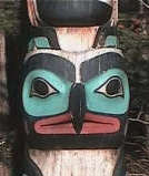 Close of up a face on a totem pole.