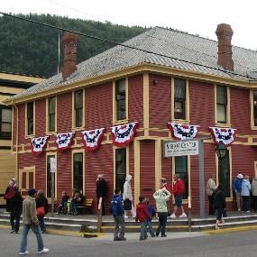 Modern photo of Klondike Gold Rush's visitor center decked out with patriotic bunting
