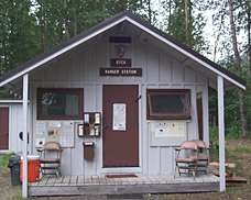 "Small cabin with sign above the door reading ""Ranger Station."""