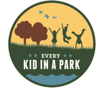 "Logo showing three children playing outside with words ""Every Kid In A Park"""