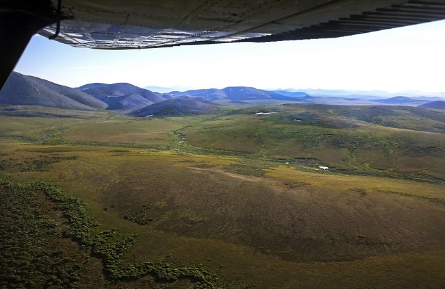 aerial view of the tundra with plane wing in the corner