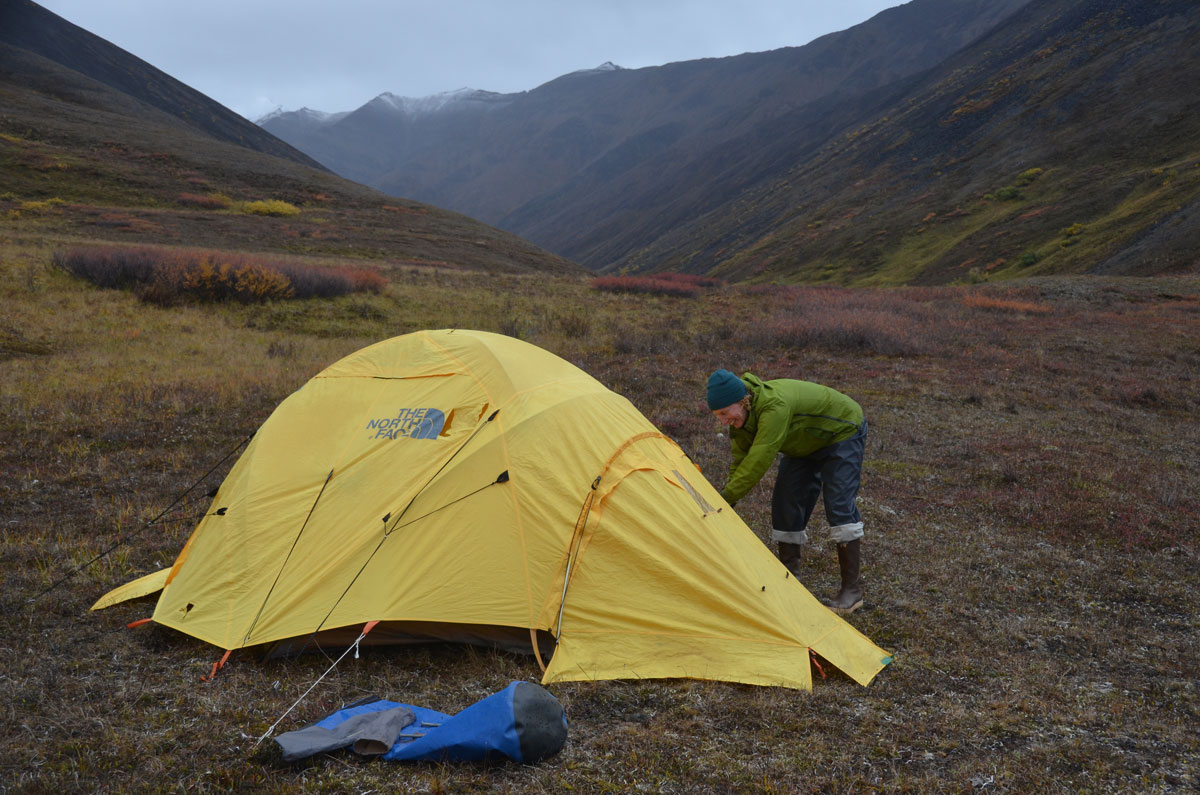 MK MacNaughton pitching a tent in the backcountry