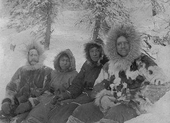 black and white photo of four men in parkas