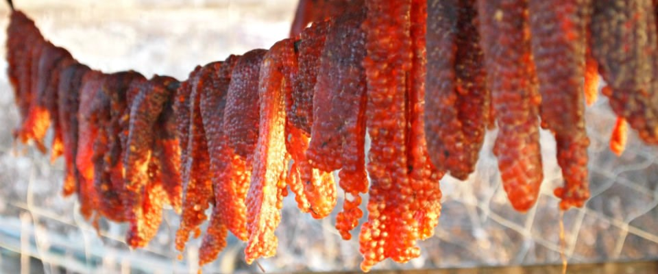 red fish eggs drying on a rack