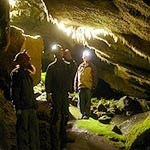 Visitors explore a cave
