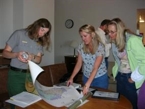 Teachers and a Ranger working together at a teacher workshop