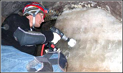 Drilling an ice core out of a cave for testing