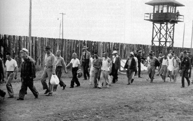 People of Japanese decent being moved from one area to another in the incarceration camp circa 1942.