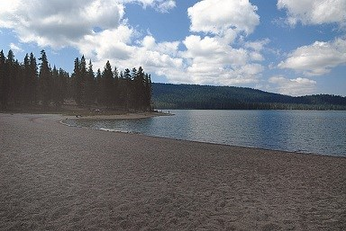 Medicine Lake beachfront with blue skys and clear water.