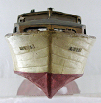 wooden model boat, viewed from the bow end