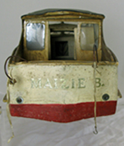 wooden model boat, viewed from the stern. the words Maizie B are visible in gold paint