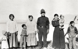 historic image of a man, woman and six children of various ages