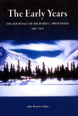 Book cover features a photograph of a cabin in the winter, surrounded by trees and snow.