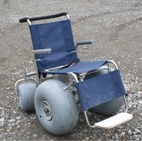 photo of a wheel chair with large tires for use on gravel and rocky surfaces.