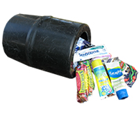 photo of a small, black, plastic barrel laying on it's side with food and toiletries spilling out of it.