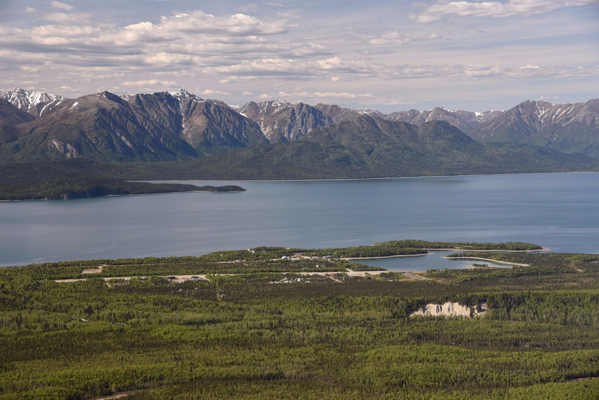 An aerial image of a Port Alsworth on the shore of Lake Clark
