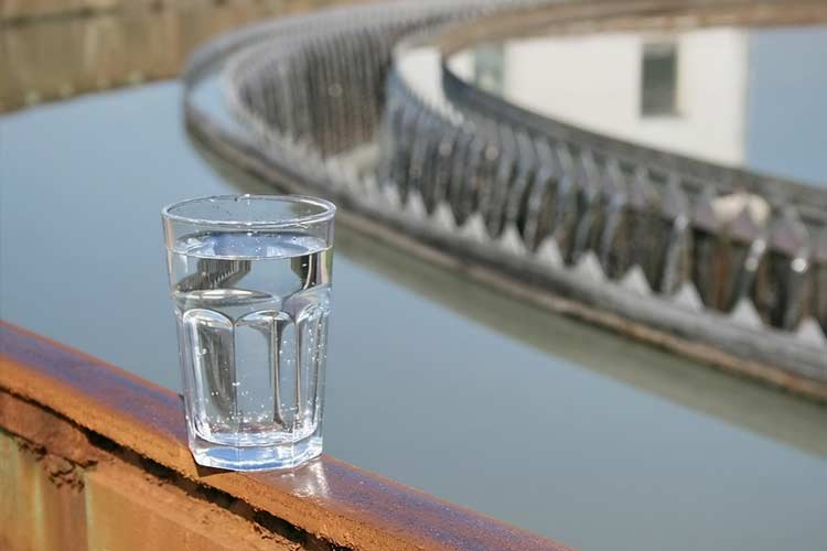 A glass of water sits at a treatment facility