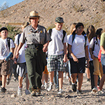 Ranger hiking with students