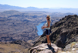 Adventurer in the Black Canyon Wilderness looking over the Colorado River below Hoover Dam