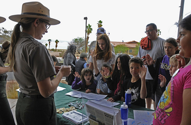 Ranger Szubota leads event attendees in the swearing in ceremony at Lake Mead National Recreation Area's Junior Ranger Day April 25, 2015.