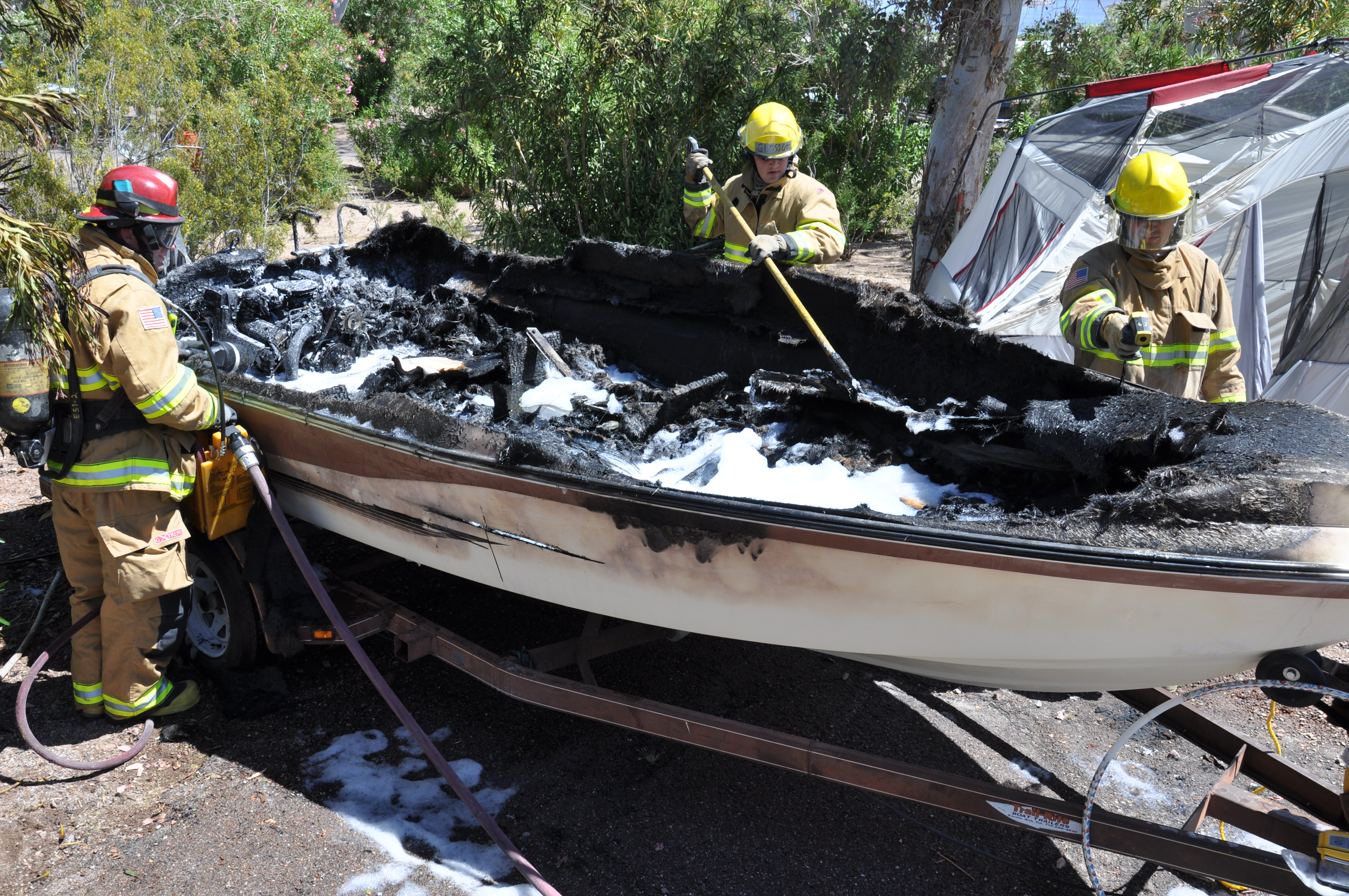 BOULDER CITY, Nev. (Apr. 22, 2011) - National Park Service rangers and Boulder City firefighters extinguish a boat fire located in the Boulder Beach campground caused by ignited fuel vapors. No injuries.