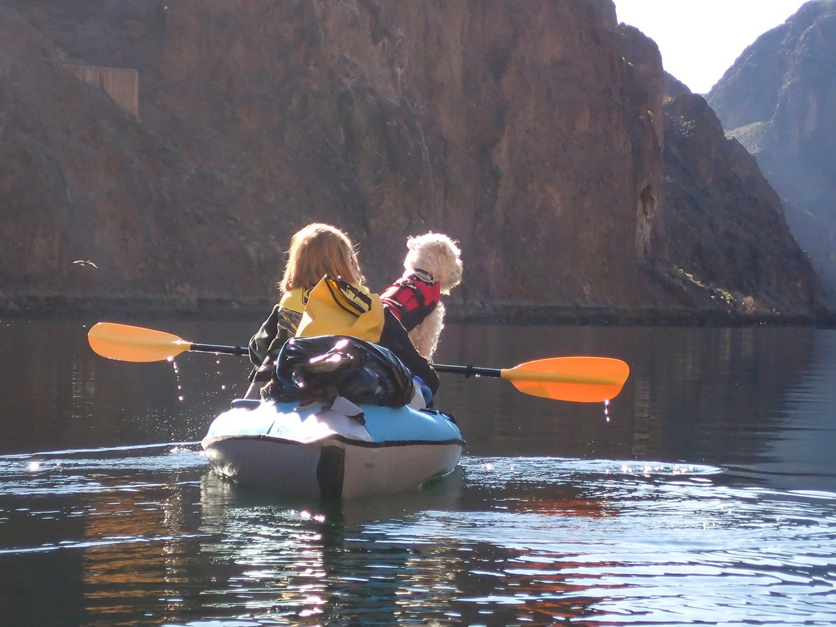 woman kayaking with dog in Black Canyon