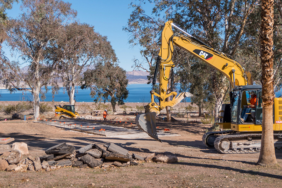 Large backhoe works to improve camping pad at Boulder Beach Campground