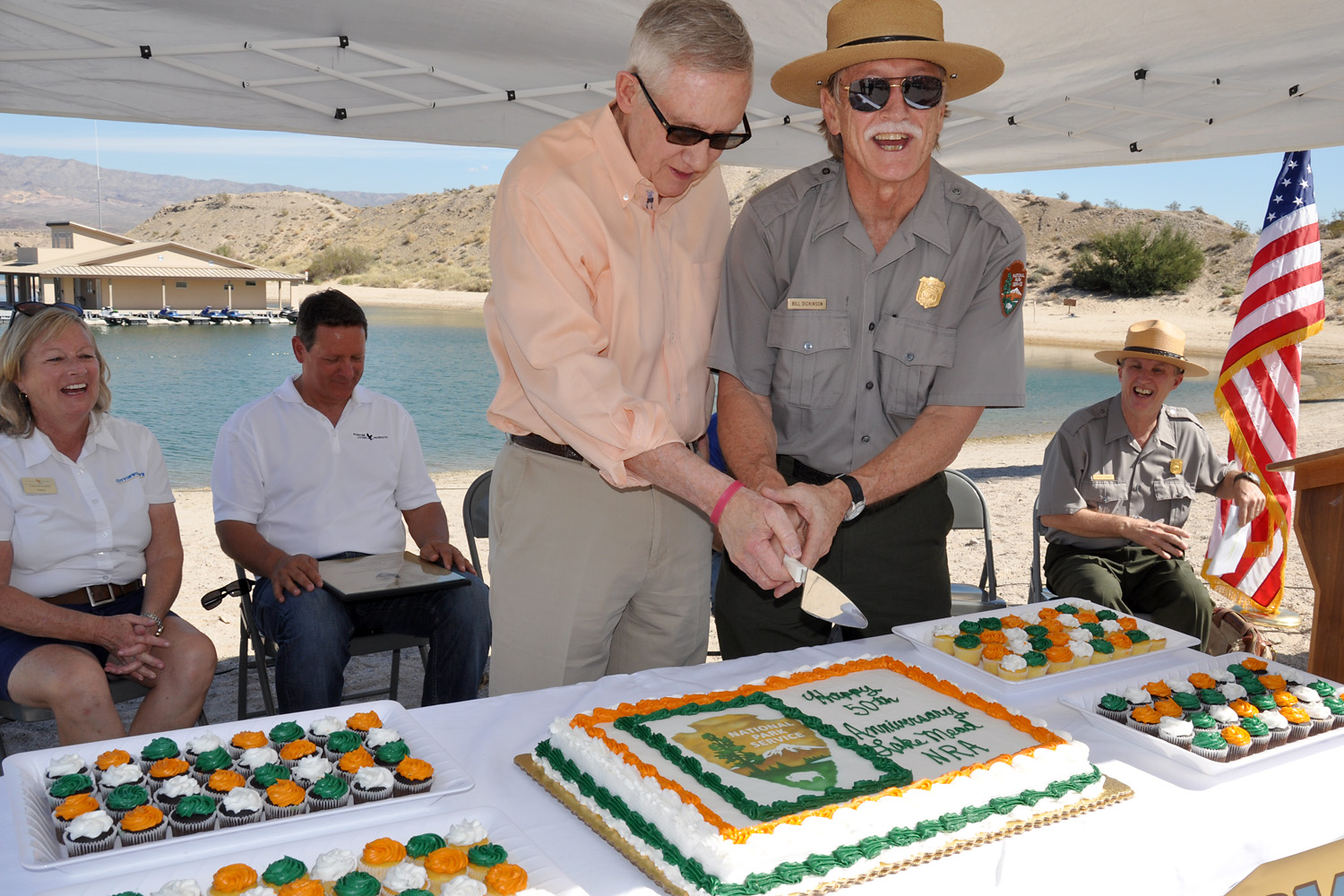 U.S. Sen. Harry Reid and Lake Mead National Recreation Area Superintendent Bill Dickinson prepare to cut a birthday cake to celebrate the park's 50th anniversary.