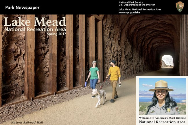Two young adults walking dog through a tunnel on the Lake Mead Historic Railroad Trail