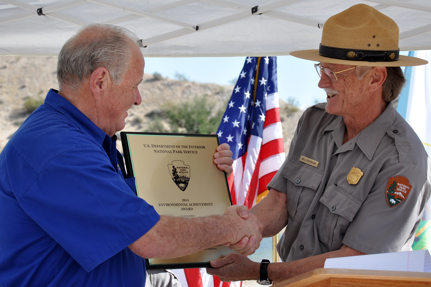On behalf of National Park Service Director Jonathan Jarvis, Superintendent Bill Dickinson presents John Schoppmann, Forever Resorts' executive vice president, with the 2014 National Park Service Environmental Achievement Award for Green Innovation.