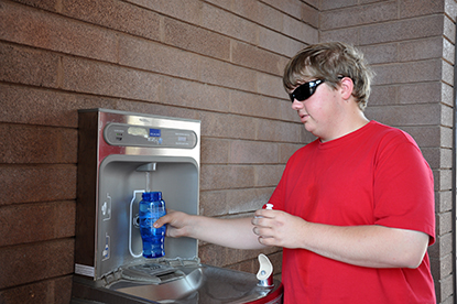 Jacob Vanlue, 17, from O'Fallon, Mo., fills up his water bottle at the hydration station at the Alan Bible Visitor Center at Lake Mead National Recreation Area. Six months after being installed, the station has filled more than 13,600 bottles, reducing water bottle waste in landfills.