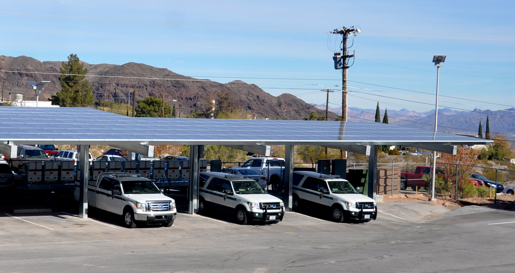 Three photovoltaic systems were added to an administrative area at Lake Mead National Recreation Area to reduce energy costs. PV panels are also located at the visitor center and native plant nursery.