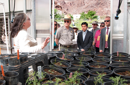 Alice Newton, Lake Mead National Recreation Area vegetation manager, explains the improvements made to the greenhouses during the grand opening of the Song Dog Native Plant Nursery April 22, 2013. (NPS Photo by Andrew J. Cattoir)