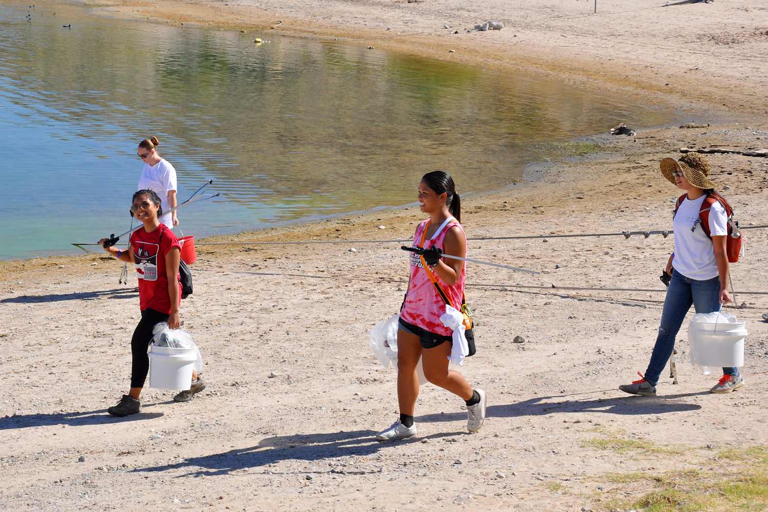 More than 150 volunteers and certified divers picked up litter around the beaches and under the marina at Cottonwood Cove to cleanup the park after a busy summer Oct. 11, 2014.