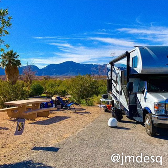 rv parked in a campsite with mountain views