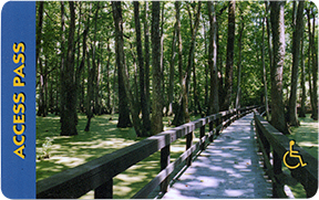 Pass card with photo of wooden walkway through wooded area