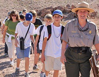 Photo of Park Ranger leading group of youth and adults on a trail in the Muddy Mountains Wilderness