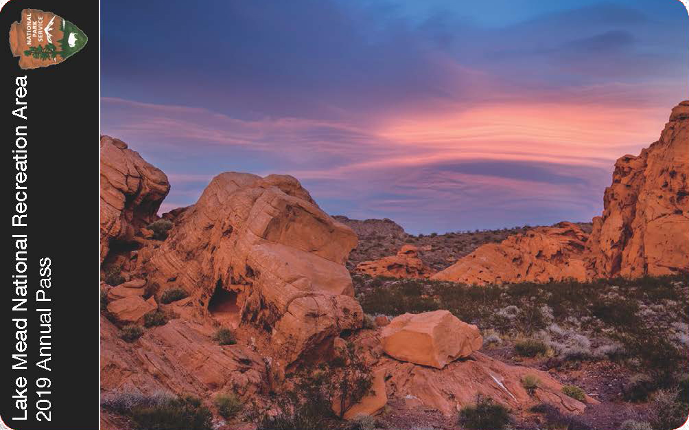 Pink and lavendar clouds at sunset over redrock formatons