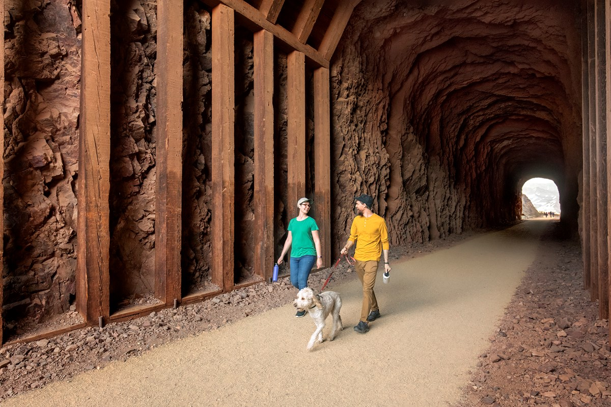 two people walking through tunnel