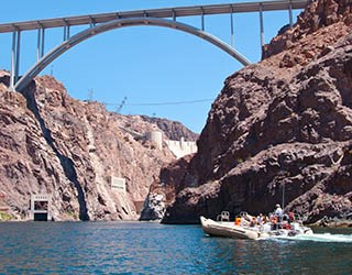 Visitors riding pontoon raft on the Colorado River in Black Canyon