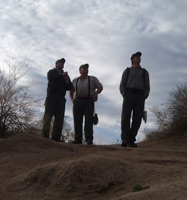 Three hikers enjoying a late afternoon hike