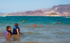 Swimmers enjoying the waters at Boulder Beach of Lake Mead