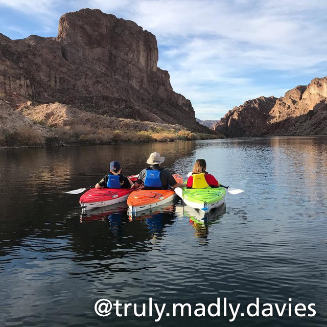 three kayaks resting along the river in the canyon