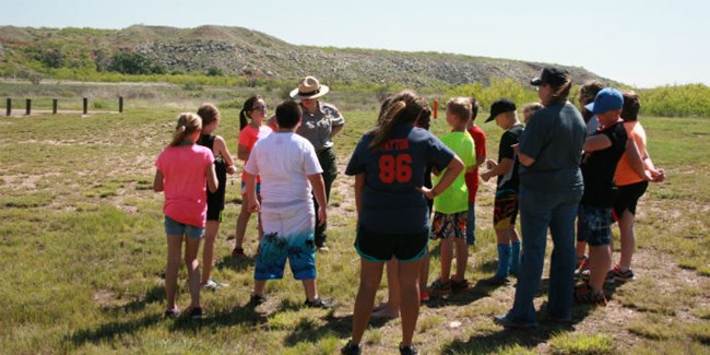 Class discussing their field trip activity with a ranger.
